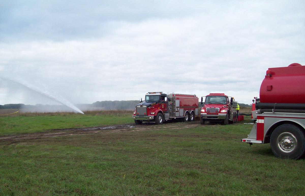 Fire Trucks in a Field